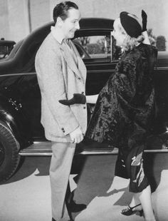 """"""" Fredric March and Carole Lombard chat at Selznick International Pictures during the filming of Nothing Sacred, 1937 """""""