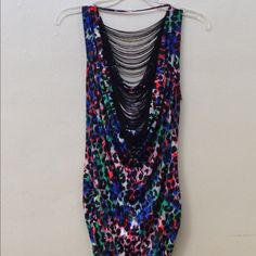 NWOT cheetah print fringe tank Gorgeous multicolored cheetah print tank with fringe on the back! First photo shown is the back. Size M. New without tags! No defects or damages. Deb Tops Tank Tops
