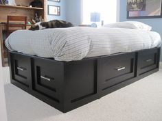 Pottery Barn Stratton knock off #2  Home-made bed using shelves as foundation. For the kids :-)