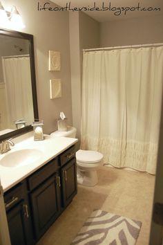 Cute Contemporary Gray Bathroom With White Ruffle Shower Curtain Zebra Bath Rug Dark Cabinets