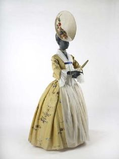 Silk robe, c. 1745-50. Shown with a Phillip Treacy saucer hat. The stomacher, chemise and sleeves are repro.