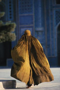Street scene in Mazar-e-Sharif, Afghanistan - Afghan woman on street - by Farzana Wahidy (she is the first female photographer in Afghanistan to work with international media like the AP and Agence France-Presse. Farzana is telling story of Afghanistan from the inside.