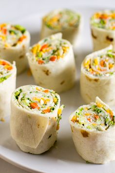 Vegetable Tortilla Roll Ups. Delicious appetizer with cream cheese filling spread on tortillas, topped with veggies and cheese. Slice and serve. Just like veggie pizza! Veggie Roll Ups, Veggie Pizza, Pizza Roll Up, Appetizer Recipes, Appetizers, Roll Ups Recipes, Tea Recipes, Healthy Recipes, Cowboy Caviar