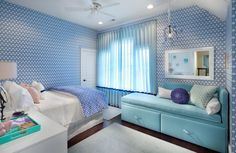 Wonderful Blue Teenage Girl Room Design With Cute Sofa Bed Beside Mirror Wall Mounted As Well Beautiful Blue Wallpaper And Curtain Covering Window As Well White Rug On Wooden Floor Blue Teenage Girl Room Providing Adorable and Delicate Interior http://seekayem.com