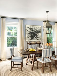 A photograph by Stephen Inggs creates a focal point in an East Hampton, New York, dining room.