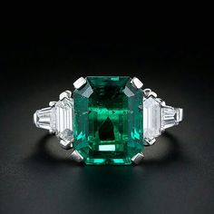 simply stunning and substantial emerald is the star of this classic platinum ring. The carat vibrant bluish green emerald is embraced on either side by a high quality hexagonal and tapered baguette cut diamond giving the ring a clean architectural design. Emerald Ring Vintage, Emerald Jewelry, Vintage Rings, Emerald Rings, Ruby Rings, Diamond Rings, Silver Jewellery, Art Deco Emerald Ring, Gemstone Rings