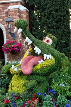 Epcot International Flower & Garden Festival is an annual event held each spring at Epcot theme park at Walt Disney World Resort. All over the park there are stunning topiaries. Part on the United Kingdom pavilion has the characters of Peter Pan.