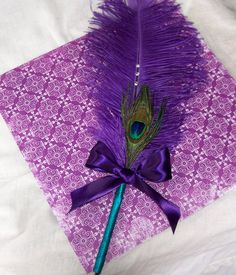 I want you to have a really big and flamboyant feather pen for your wedding guest book.