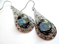 Dichroic Glass Earrings/ Fused Glass Earrings/ Dangle Earrings/Gun Metal/French Hook Earrings. $ via Etsy.