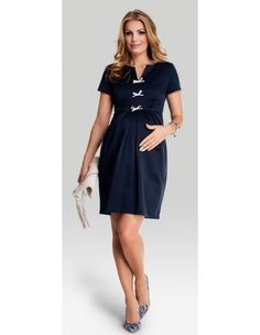 The dress accentuates the gorgeous bump finishing above the knee and the pleats offer room for when the bump grows.