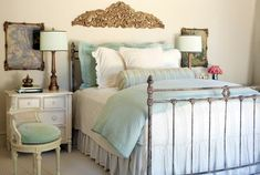 Pretty woodcarving over an amazing antique bed frame,