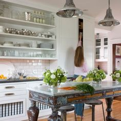 No upper cabinets...once again. Narrow Island/table with matching top as the cabinets.