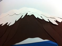 Version 1 of Mauna Kea for book1 of Windows to Adventure - Which of the Mountains is Greatest of All? cut-paper artwork by Terry Lim Diefenbach. copyright Red Phoenix Books.