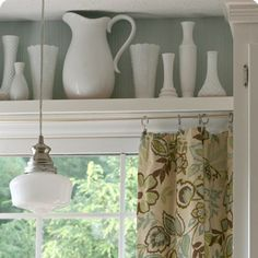 The shelf above the window & the curtains... Anybody know what this fabric is? It would match my kitchen walls perfectly.