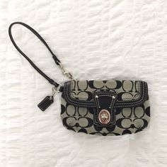 Coach Wristlet VGUC! Only been used a few times, has some light wear but lots of life left! Two pockets, one at zipper and another at front closure. Coach Bags Clutches & Wristlets
