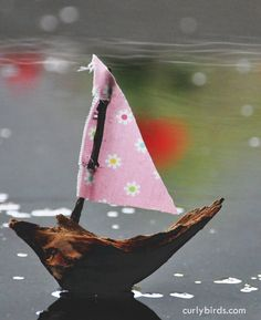 """A piece of wood, a morning of rain, a scrap of fabric, and a little bees wax. A simple boat. The art of play."""