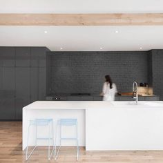 We're going to post five popular kitchens from the pages of Dezeen today. Materials uncovered during the renovation of this early-20th-century apartment in Montreal were used to add texture to the space and create visual boundaries between each room. The kitchen area is defined by tonal shades of grey with the cabinets and quartz countertops aligning against a painted brick wall. See more kitchens on http://ift.tt/1QUz1Np Photography is by Adrien Williams. #architecture #interiors #kitch...