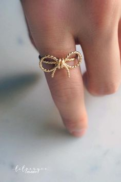 {{ s w e e t l y collection }} feminine. flirty. and just sweet enough.  NEW heavy gauge twisted wire is formed into ribbon style bows. Looks super dainty and sweet, but feels sturdy and wont bend out of shape easily. Available in sterling silver or 14K goldfill. >>>>>>>>>>>>>>>>>>>>>>>>>>>>>>>>>>>>>>  ► Made in any size: Please note desired size in notes to seller upon checkout. ...