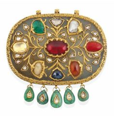 A LARGE NAVRATNA GEM-SET JADE PENDANT NORTH INDIA OR DECCAN, 19TH OR EARLY 20TH CENTURY Of oval form, typically inset with nine different gems, overlaid in gold with floral sprays and diamond-set buds, five drop-shape emerald pendants along the lower edge possibly added later, the reverse applied with gold borders finely engraved with meandering flowery vine, three hanging loops at top