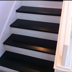 $265 Stair makeover!  Ripped up my carpet, cut and installed Oak risers from Lowe's and stained them with Minwax PolyShades in Classic Black.  Lots of labor, cheap makeover!