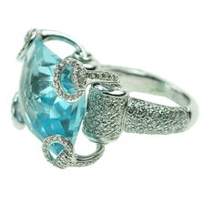 "Gucci - A blue topaz and diamond ""Horsebit"" ring, the modified rectangular cut blue topaz within a raised pave-set diamond mount with open equestrian style prongs mounted in 18kt white gold. Total weight of diamonds approximately 2.90 carats"