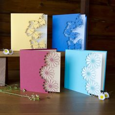 handcrafted cards ... beautiful color .... butterfly  or daisy ... machine cut borders with lacy flowers or butterflies ...
