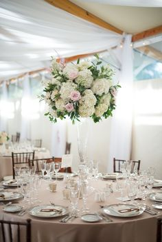 Hydrangea and Roses tall centerpiece    Photo by Jaclyn L Photography