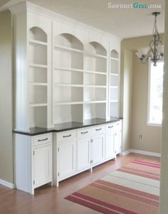 DIY Dining room built-in buffet. This blogger is one of the most AMAZING carpenters I have ever met. You should see the closet she built! @Sandra Powell {Sawdust Girl}