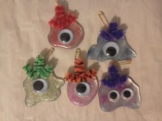 These are just a few of the Girl Scout SWAPS I made for the Alien Invasion Adult Camporee. I love these little aliens, they cracked me up while I was making them. Hot glue, foil, embroidery thread, safety pins, glitter, pipe cleaners and googly eyes.
