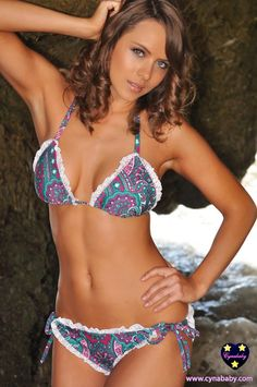ok i might need this! Cynababy Swimwear // Spades of Crochet White Ruffle Swimsuit - Teal Paisley