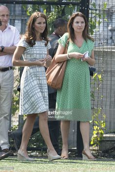 Catherine, Duchess of Cambridge with Rebecca Deacon, (private secretary to Catherine, Duchess of Cambridge) during a visit by Prince William and Catherine, Duchess Of Cambridge with Prince Harry to a sports-themed event at Bacon's College in London, to launch The Coach Core Programme on July 26, 2012 in , United Kingdom. (Photo by Mark Cuthbert/UK Press via Getty Images)