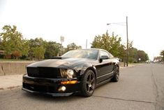 """""""First Drive: 2009 Roush Stage 3 BlackJack """", Winding Road, October 2008 . Ford Mustang Roush, 2009 Ford Mustang, Ford Mustangs, Roush Stage 3, Fifth Gear, Stealth Bomber, Sport Seats, Chrome Wheels, Shelby Gt500"""
