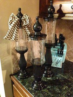 Made from used candle jars glued to candle sticks.