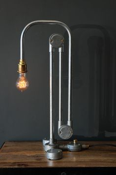 This paperclip table lamp has a wonderful industrial feel Designed and hand made by Tony Miles Tony hand makes the industrial bespoke lighting