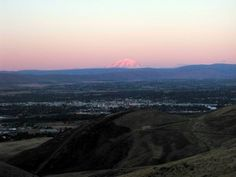 Glacier-clad Mount Adams is visible from much of the Yakima Valley. The distant ridge is more than a mile high, while Adams rises to 12,280-foot elevation.