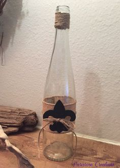 Paris inspired wine bottle with twine and fleur de lis.