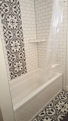 Our bathroom remodel project. Features Artea porcelain tile from Wayfair.