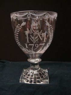 Georgian toasting goblet dated 1797 with initials and other engraving, raised on traditional Lemon squeezer square base. In very good condition for its age