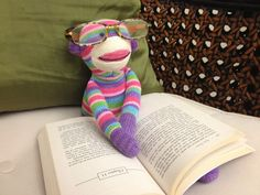 """Would love to pick up this sock monkey & a new book for my niece's birthday! """"Pier 1 Imports: Pier 1 Rainbow Sock Monkey catches up on some reading"""""""