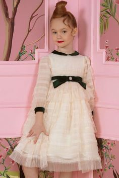 Perfect girls party or flower girl dress! Stunning ivory tulle dress has beautiful layers of soft tulle with a green velvet bow, collar, and diamanté jewel detail. Looks perfect with a pair of Manuela de Juan White Patent Leather Pumps. Shop @ Childrensalon. #girlsdress #flowergirl #designergirlsdress #dashinfashion