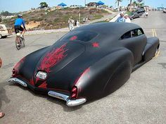 Hot Rod with Awesome Pinstriping on flat black paint.
