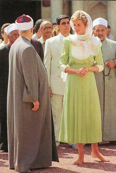 Catherine Walker calf-length pale green silk dress. The dress has three-quarter sleeves, a white yoke and cuffs, a pleated skirt and a cummerbund made in the same green silk as the dress. 05 May 1992   Duchesse Or Ange