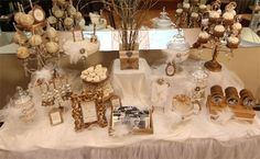 Wow check out this Old Hollywood Candy & Dessert Table all in Gold and White. Now that is a fancy candy bar!!