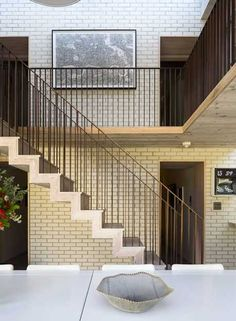 modern interiors with staircase and brick wall design