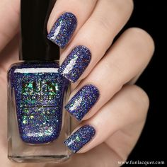 $12.00Exquisite is a purple/blue holographic glitters polish with amazing colour shifting flakes which shift between blue-to-green-to-gold. It's...