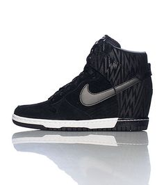 NIKE Women's high top wedge sneaker Padded tongue with NIKE logo Zig Zag print design on upper Lace closure Cushioned sole for ultimate comfort