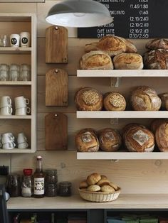 Coffee shops and bakeries might give out their baked goodies at the end of the day. | 24 Stingy Hacks For The Cheapskates In All Of Us interior design, chopping boards, shop, baked breads, magpi bakeri, bakeries, chalkboard, cheese boards, open shelving