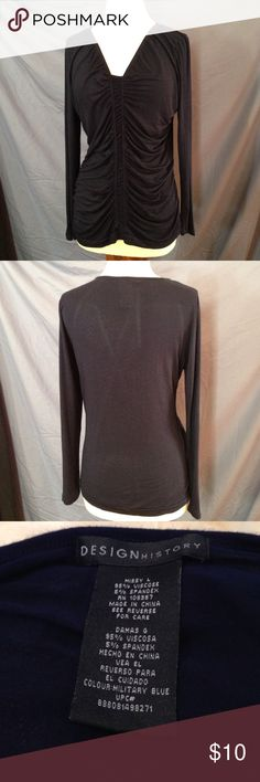 Navy Blue Gathered Front Design Long Sleeve Top Bust 39 Length 27 Material stretches This top is excellent condition with. I rips, stains or tears. it has a relax fit and very comfortable. the top is a very dark navy blue and the last picture best represents the color. I had to lighten the first picture to see the gathering. Design History Tops Blouses