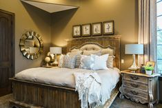Rustic elegance! This master bedroom suite is perfect. Comfortable, rich, lush fabrics and furnishings. Fluff Interior Design - Decorating for REAL life. Omaha, NE.