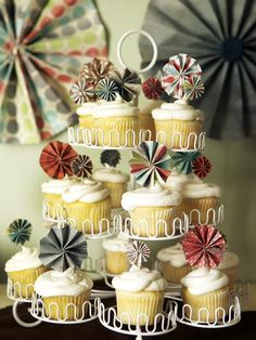 DIY Weddings: Cake Topper Ideas and Projects: Using strips of colorful craft paper, toothpicks and a glue gun, you can create cupcake pinwheel toppers. For a vintage twist, personalize your cupcake toppers with antique buttons — maybe a few from your mother's wedding dress. Design by Kellan Studios From DIYnetwork.com